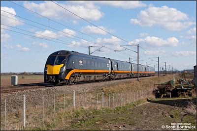 180114 passes Broad Fen Lane, Claypole whilst forming 1D73 1448 London King's Cross-Bradford Interchange on 03/04/2013.