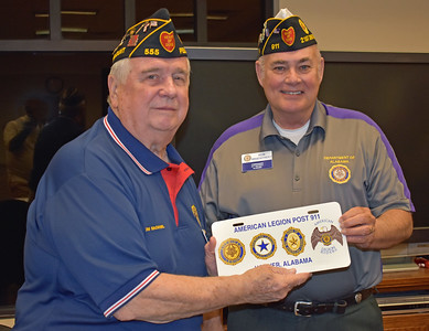 Ron Bradstreet presents Tom Mcdaniel , Post 555 Commander with Post 911 memento