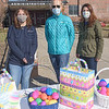 Easter Egg Hunt organizers Ariana Ciaschini, Holly Lurgio, and Michele Moriarty look over some of the goodies to be handed out.