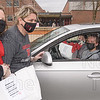 Moms Michelle Moniz and Alina Slowik bring gift bags to daughters Jessica Slowik and Emily Moniz.