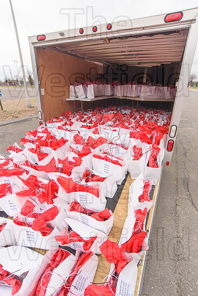 Dozens of gift bags ready for distribution.