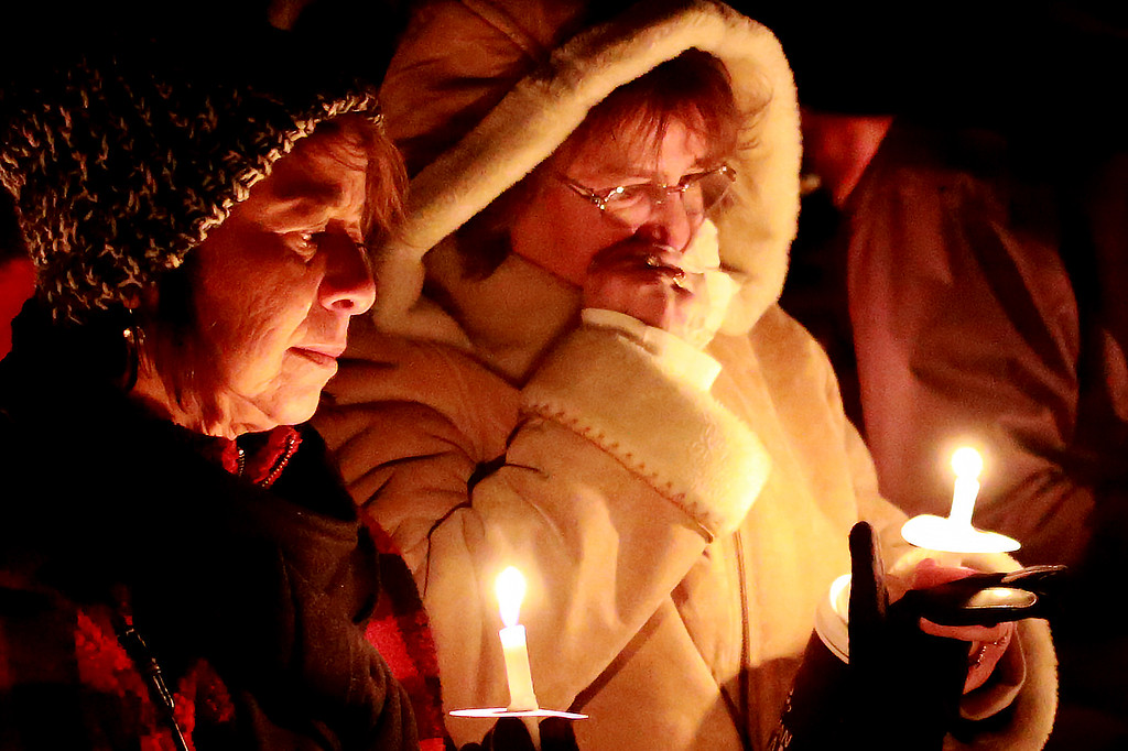 . Lubi Isringhansen and Pam Montoya stand at the McKee Angel Statue during the Angel Event hosted by 3 Hopeful Hearts during the vigil for the remembrance of children who have passed away on Dec. 9, 2018 in Loveland, Colo.  Photo by Taelyn Livingston/ Loveland Reporter-Herald