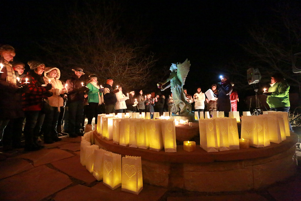 . People gather at the McKee Angel Statue at the Angel Event hosted by 3 Hopeful Hearts on Dec. 9, 2018 in a vigil for remembrance of children who have passed away in Loveland, Colo.  Photo by Taelyn Livingston/ Loveland Reporter-Herald