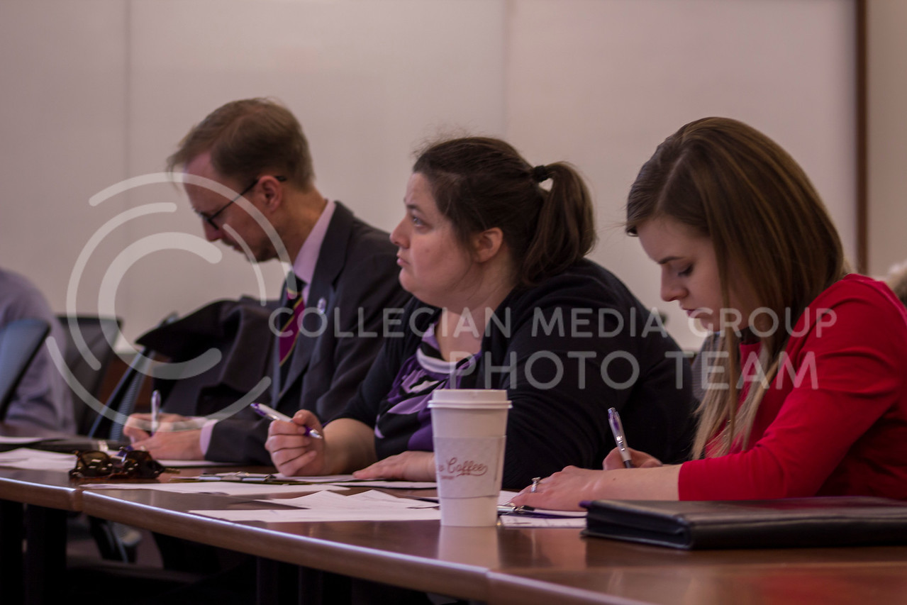 While taking notes, the judges score the contestants during the 3 minute thesis competition on Feb. 13, 2018 at the College of Business Building. (Andrea Klepper | Collegian Media Group)