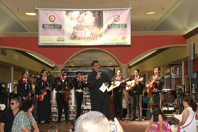 May 12, 2013 - At the annual MOTHER'S DAY celebration at the Panorama Mall with Los Mariachi Palmeros.  EVERYONE had a great time.  Rudy Garcia, lead Mariachi singer for Los Palmeros, is a very outgoing friendly singer.  The customer's, at the Panorama Mall, love it when Los Palmeros are playing at the Mall.  Everyone is singing along, clapping hands, and getting sentimental about their Mom's.  People are welcomed to come onto the stage to sing their favorite songs.  Children, and Adults, are taking photos / video of their favorite Mariachi.  The Master of Ceremonies is Francisco Verdin - El Voz de Valle....does a great job of introducing the songs, and informing the Panorama Mall customers of Sales, Bargains, Places to Eat, Sponsors, Upcoming events; and more.    Go to WWW.FACEBOOK.COM/PANORAMAMALL for upcoming events, sales, and more.  The photos/video are FREE to download Courtesy of the Panorama Mall and the Ralph Godoy Photographic Group.  Enjoy the video clips on page one.  The clips will give you an idea of how Los Palmeros de Panorama Mall, M.C. Francisco Verdin, children, and customers all interacted to make Mother's Day a memorable day.
