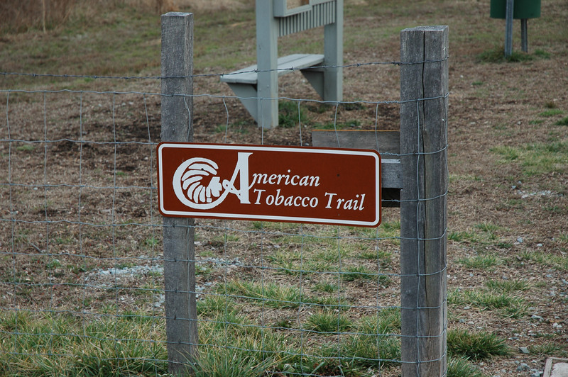 """<a href=""""http://www.flickr.com/people/lymang/"""">Photo Courtesy of Lyman Green</a>  The American Tobacco Trail is a 22 mile Rail-Trail that runs from Durham south to Apex, North Carolina on the former Norfolk Southern Railroad line. The name of the trail reflects the main cargo of the railroad which was built in 1906. The northern section of the trail is paved but some of the southern sections are largely grass or clay. South of I-40 and Massey Chapel Road, the trail opens up to equestrian use and winds through piney woods and neighborhoods. The trail offers the chance to view lots of wildlife including beavers, herons, hawks, songbirds, vultures, squirrels, owls, and deer.  The Rail-Trail was funded through 8 separate Transportation Enhancement projects from 1996-2006. In total $2.6 million in TE funding was awarded for the construction of the trail with another $650,000 in local match funds. The trail was completed in early 2012. For more information on the trail, please visit the Triangle Rails-to-Trails Conservancy."""