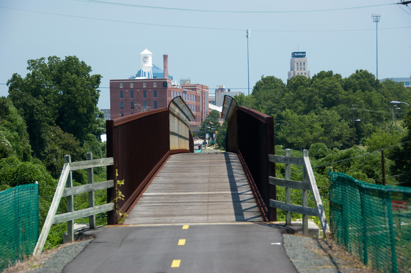 """<a href=""""http://www.flickr.com/people/reallyboring/ """">Photo Courtesy of Eric Rogers</a>  The American Tobacco Trail is a 22 mile Rail-Trail that runs from Durham south to Apex, North Carolina on the former Norfolk Southern Railroad line. The name of the trail reflects the main cargo of the railroad which was built in 1906. The northern section of the trail is paved but some of the southern sections are largely grass or clay. South of I-40 and Massey Chapel Road, the trail opens up to equestrian use and winds through piney woods and neighborhoods. The trail offers the chance to view lots of wildlife including beavers, herons, hawks, songbirds, vultures, squirrels, owls, and deer.  The Rail-Trail was funded through 8 separate Transportation Enhancement projects from 1996-2006. In total $2.6 million in TE funding was awarded for the construction of the trail with another $650,000 in local match funds. The trail was completed in early 2012. For more information on the trail, please visit the Triangle Rails-to-Trails Conservancy."""