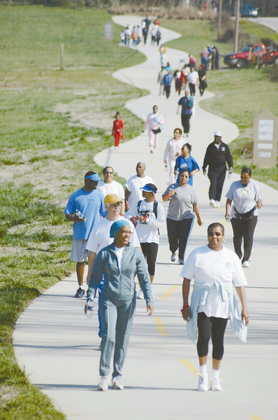 """<a href=""""http://www.pathfoundation.org/"""">Photo Courtesy of The Path Foundation</a>    The Arabia Mountain Trail is an escape route from the burgeoning metropolis of Atlanta. Located in one of the fastest growing counties in the nation, the trail connects busy commercial and residential areas with historic sites and precious parkland. A TE award helped Dekalb County and the nonprofit <a href=""""http://www.pathfoundation.org/"""">PATH Foundation</a>, a local promoter of trails and greenways, to complete the first segment of trail in 2004. The five-mile section links the Stonecrest Mall to the historic quarry town of Lithonia and the 2000-acre Arabia Mountain Park, known for its beautiful granite outcrops. When completed, the Arabia Mountain Trail will stretch twenty miles, connecting schools, parks, and residential and commercial areas in three counties. Construction of the first trail segment was made possible through an extraordinary partnership between <a href=""""http://www.co.dekalb.ga.us/"""">DeKalb County</a>, PATH, <a href=""""http://www.arabiaalliance.org/"""">Arabia Mountain Alliance</a>,  <a href=""""http://www.gastateparks.org/"""">Georgia State Parks</a> and several private businesses, including the proprietors of Stonecrest Mall who contributed money and right-of-way to the trail effort."""