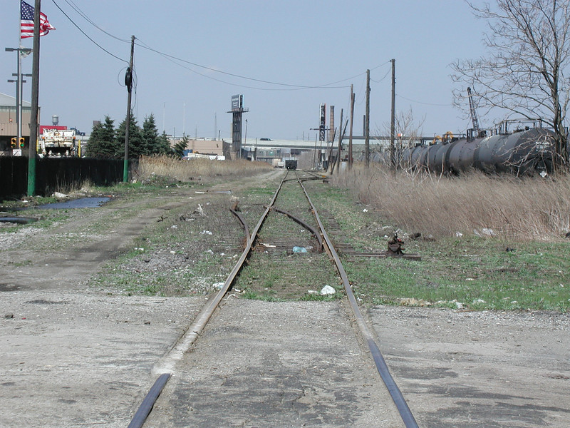 This image from the northern end of the first segment of the trail shows the condition of the corridor prior to trail development.<br /> <br /> The Dequindre Cut is a 1.2 mile rail-trail that connects the Detroit waterfront to several residential and commercial areas. This project converted an abandoned, derelict railroad corridor into a greenway, preserving the right-of-way for transportation use and creating a valuable amenity for the city and for travelers. A $2 million federal TE award in 2004 leveraged a local match of over half a million dollars to construct the first segment of the trail. The full right-of-way is over four miles long, and an extension to the first segment is already under construction.