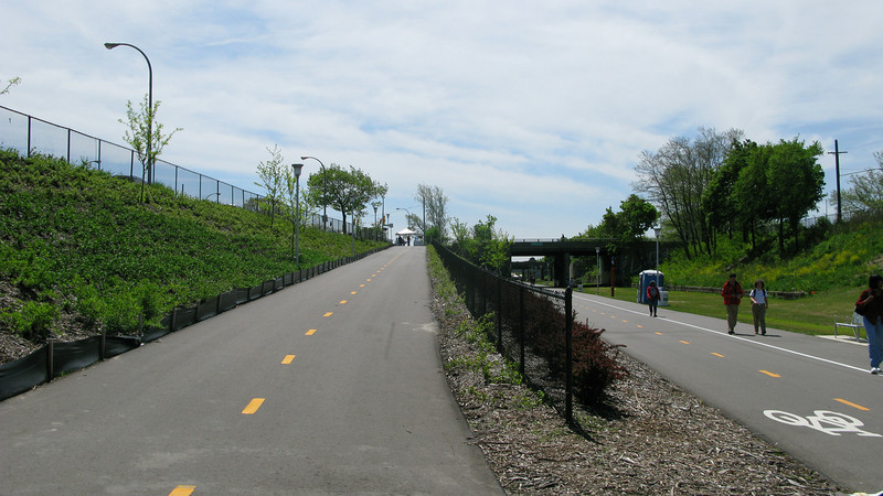 The trail was originally a line of the Grand Trunk Railroad.  Much of the right-of-way is significantly below grade.  This reduces intersection and turning conflicts, but introduces the challenge of creating safe and accessible points from which users can enter the trail. While below-grade rail lines in downtown settings are found across the US, the Dequindre Cut is unusual in that the corridor is almost 50 feet below grade, an unusually deep urban canyon.<br /> <br /> The Dequindre Cut is a 1.2 mile rail-trail that connects the Detroit waterfront to several residential and commercial areas. This project converted an abandoned, derelict railroad corridor into a greenway, preserving the right-of-way for transportation use and creating a valuable amenity for the city and for travelers. A $2 million federal TE award in 2004 leveraged a local match of over half a million dollars to construct the first segment of the trail. The full right-of-way is over four miles long, and an extension to the first segment is already under construction.