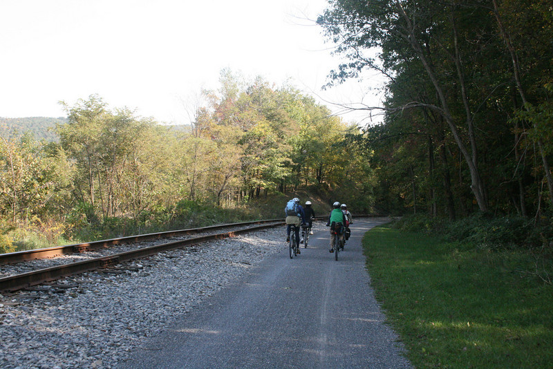 """<a href=""""http://www.flickr.com/photos/michellekc/"""">Photo Credit</a>  With 100 continuous miles of trail open in Pennsylvania from McKeesport to Meyersdale and an additional twenty miles scattered throughout the Pittsburgh area, the <a href=""""http://www.atatrail.org/"""">Great Allegheny Passage</a> is the longest multi-purpose rail-trail in the East. The rail-trail offers a total of 150 miles of non-motorized, nearly level trail between Cumberland, Maryland and Pittsburgh, Pennsylvania with a 52-mile spur to Pittsburgh International Airport. At Cumberland, the Passage will link with the Chesapeake & Ohio Canal Towpath, creating a 300-mile off-road route between Pittsburgh and Washington, DC. The Great Allegheny Passage allows hikers, bicyclists, cross-country skiers and people with disabilities the opportunity to discover the region's spectacular river gorges, mountain vistas and sweeping cityscapes. The Passage leads travelers through the Allegheny Mountains making use of refurbished railroad bridges and tunnels on their journey along waterways, unique rock formations, and wildlife areas. The trail was completed with the help of a $4 million TE grant. A public-private partnership between the Pennsylvania Department of Transportation and the <a href=""""http://www.atatrail.org/"""">Allegheny Trail Alliance</a> (a coalition of seven trail organizations in Southwestern Pennsylvania and Western Maryland), manages this comprehensive project and has significantly contributed to the project's success."""