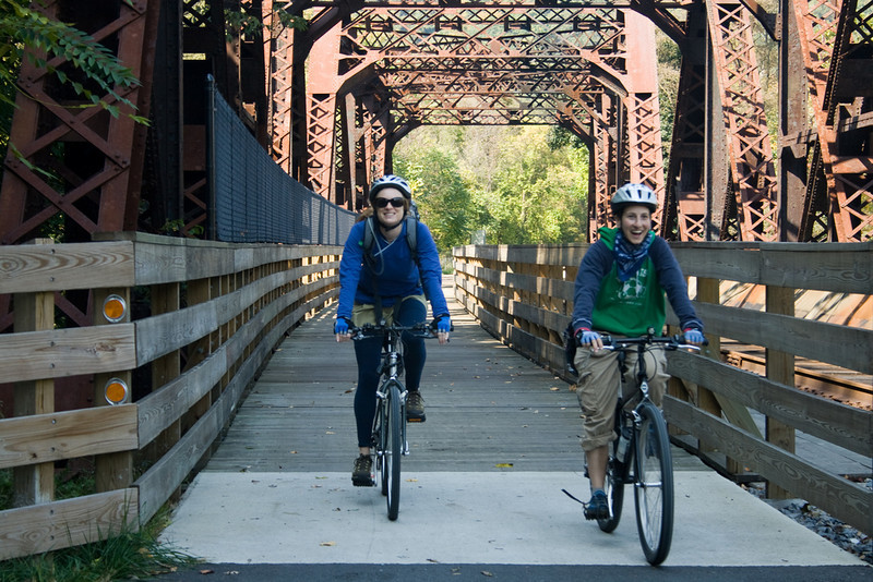 """<a href=""""http://www.flickr.com/photos/jasonpratt/"""">Photo Credit</a>  With 100 continuous miles of trail open in Pennsylvania from McKeesport to Meyersdale and an additional twenty miles scattered throughout the Pittsburgh area, the <a href=""""http://www.atatrail.org/"""">Great Allegheny Passage</a> is the longest multi-purpose rail-trail in the East. The rail-trail offers a total of 150 miles of non-motorized, nearly level trail between Cumberland, Maryland and Pittsburgh, Pennsylvania with a 52-mile spur to Pittsburgh International Airport. At Cumberland, the Passage will link with the Chesapeake & Ohio Canal Towpath, creating a 300-mile off-road route between Pittsburgh and Washington, DC. The Great Allegheny Passage allows hikers, bicyclists, cross-country skiers and people with disabilities the opportunity to discover the region's spectacular river gorges, mountain vistas and sweeping cityscapes. The Passage leads travelers through the Allegheny Mountains making use of refurbished railroad bridges and tunnels on their journey along waterways, unique rock formations, and wildlife areas. The trail was completed with the help of a $4 million TE grant. A public-private partnership between the Pennsylvania Department of Transportation and the <a href=""""http://www.atatrail.org/"""">Allegheny Trail Alliance</a> (a coalition of seven trail organizations in Southwestern Pennsylvania and Western Maryland), manages this comprehensive project and has significantly contributed to the project's success."""