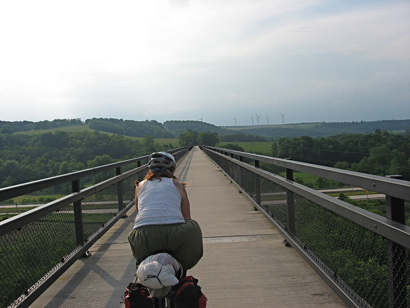 "<a href=""http://www.flickr.com/photos/34742422@N00/"">Photo Credit</a>  Riding over the Salisbury Viaduct.  With 100 continuous miles of trail open in Pennsylvania from McKeesport to Meyersdale and an additional twenty miles scattered throughout the Pittsburgh area, the <a href=""http://www.atatrail.org/"">Great Allegheny Passage</a> is the longest multi-purpose rail-trail in the East. The rail-trail offers a total of 150 miles of non-motorized, nearly level trail between Cumberland, Maryland and Pittsburgh, Pennsylvania with a 52-mile spur to Pittsburgh International Airport. At Cumberland, the Passage will link with the Chesapeake & Ohio Canal Towpath, creating a 300-mile off-road route between Pittsburgh and Washington, DC. The Great Allegheny Passage allows hikers, bicyclists, cross-country skiers and people with disabilities the opportunity to discover the region's spectacular river gorges, mountain vistas and sweeping cityscapes. The Passage leads travelers through the Allegheny Mountains making use of refurbished railroad bridges and tunnels on their journey along waterways, unique rock formations, and wildlife areas. The trail was completed with the help of a $4 million TE grant. A public-private partnership between the Pennsylvania Department of Transportation and the <a href=""http://www.atatrail.org/"">Allegheny Trail Alliance</a> (a coalition of seven trail organizations in Southwestern Pennsylvania and Western Maryland), manages this comprehensive project and has significantly contributed to the project's success."