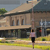 "<b>Williamson Bikes and Fitness, housed in a renovated train depot, is located adjacent to the Greenbush Link.</b>  The ""Greenbush Link"" is a 1-mile segment of the Southwest Path in Madison, Wisconsin (Dane County). The Southwest Path is 5.6 miles in length and is the northern reach of the Badger State Trail, a 40-mile trail that connects Madison to Freeport, Illinois.   In 2002, Wisconsin Department of Transportation awarded the City of Madison a $1.46 million TE grant to construct the Greenbush Link portion of the trail, which had become known as the ""missing link."" Completion of this ""missing link"" in 2006 closed the 18-mile loop around central Madison and along the Nine Springs E-Way. It also connects the Southwest Commuter Path with the Isthmus Bike Path and the Capital City Trail as well as regional trails such as the Military Ridge State Trail.   This 1-mile corridor in downtown Madison was very difficult for the Madison Department of Transportation to assemble due to physical constraints and property ownership challenges. Ultimately, the city pieced together a corridor that involves rails-with-trails, easements from the University of Wisconsin and private properties, renegotiation of leases with three commercial property owners, two new crossings of active rail line, and other miscellaneous property agreements. Extensive retaining walls built as well as a new bridge over an arterial street were constructed. The total cost of the construction was approximately $3 million. Land costs added approximately $400,000 to the final price tag."