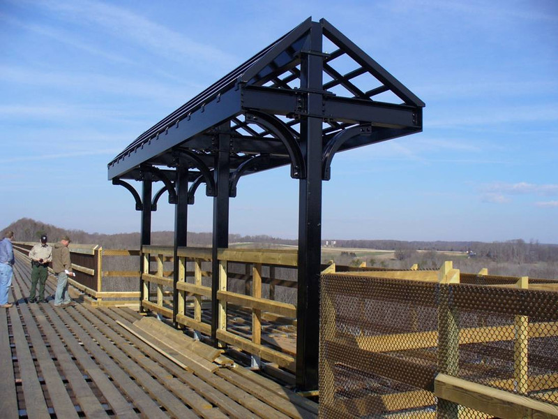 "The original High Bridge was constructed in 1853 and played a significant role in General Lee's retreat during the Civil War. During the Battle of High Bridge on April 7, 1865, the original bridge was partially burned by Confederate Troops. The current bridge was completed in 1914 and is the longest recreational bridge in the Virginia. The 2,400 foot long bridge sits 125 feet above the Appotmattox River and is part of a 31 mile shared-use trail built on Norfolk-Southern Railway right of way which was donated to the <a href=""http://www.dcr.virginia.gov/"">Virginia Department of Conservation and Recreation</a>. The trail permits biking, hiking, and horseback riding.   The restoration of the bridge received $743,000 in regular TE funding and an additional $2,000,000 in ARRA funding through the TE program. The funding paid for re-decking the entire bridge and constructing overlooks with steel canopies. More than 330,000 screws, 13,000 bolts of various sizes, and 1,065 railroad ties were used to renovate the bridge.  The contractor for the project was <a href=""http://www.kbc-inc-va.com/"">Keith Barber Construction, Inc</a>.   The 1,108 acre park runs through Appomattox, Nottoway, Cumberland, and Prince Edward counties. The trail also connects 4 other TE projects together. The Burkeville Station, Pamplin Station, and Farmville Depot are located along the trail and were all restored and rehabilitated with TE funding. Farmville also has a successful streetscape project near Longwood University. There is still work to be done on the trail but DCR has money set-aside to finish the terrific park. <a href=""http://www.youtube.com/watch?v=Pt2w0MypNxs"">To see video of the park, click here!</a>"