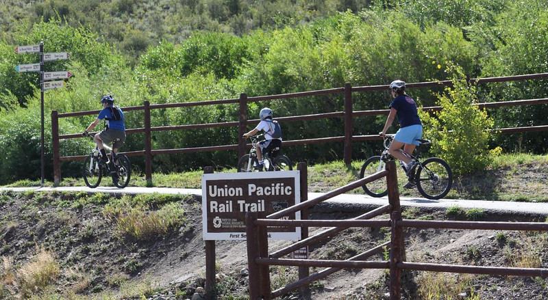 """Photo Credit: Darren Alff  The <a href=""""http://stateparks.utah.gov/parks/historic-union"""">Historic Union Pacific Rail Trail</a> runs 28 miles from Park City, UT north to the Echo Reservoir through Coalville. The rail trail follows the path of I-80 and is also a state park. The beautiful trail is set amongst the snow-capped backdrop of the Wasatch mountain range. In the summer time the trail is popular with bicyclists and walkers and provides a great starting point for accessing many of the nearby trails. The trail is also open for equestrian use. In the winter time the trail is used mainly by snowshoers and cross-country skiers.  The rail trail was funded by six separate TE projects. The projects occurred in 1992, 1994, 2001, 2005, 2008, and 2009 and received a total of $1.13 million in TE funding. Another $502,000 was contributed as the local match. The 30% local match contributed to these projects helped to design, acquire, and pave the trail. The trail is primarily crushed stone but is paved near Park City and Wanship. The rail trail is maintained by the <a href=""""http://mountaintrails.org/""""> Mountain Trails Foundation</a>   The trail will serve as the backbone to the Wasatch Loop Trail. The Wasatch Loop trail will create a loop connecting South Ogden, Park City, Heber, Provo, Salt Lake City, and many of the sounding areas. For more information on the trail contact the Historic Union Pacific Rail Trail State Park at P.O. Box 754, Park City, UT, 84060-0754 or call the park at (435) 649-6839."""