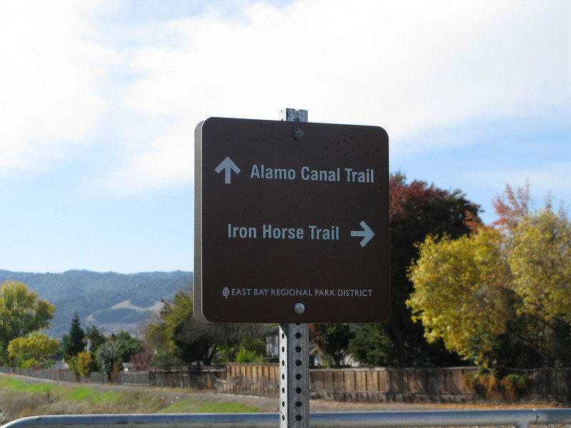 <b>The trail is an integrated part of a larger nonmotorized transportation system.</b>  The Iron Horse Regional Trail connects two counties and 12 cities along 33 miles of the Southern Pacific Railroad right-of-way.  Between 1997 and 2002, $3,107,000 in TE funds financed trail expansion and infrastructure, including under- and over-passes.  The Iron Horse Regional Trail is open to pedestrians, bicyclists, and equestrians.  The trail is a popular route for commuters as well as school children.  It is convenient to a Bay Area Rapid Transit (BART) station, bus stops, and park-and-ride facilities.  The trail passes through commercial areas that have benefited from the establishment of the trail.  Restaurants, ice cream parlors, and bicycle and sporting goods stores have specifically located themselves alongside the trail.  Many businesses now include bicycle parking in support of the trail.  The Iron Horse Regional Trail provides thousands of citizens an alternative way to travel while serving as a linear park and greenway providing habitat for wildlife.