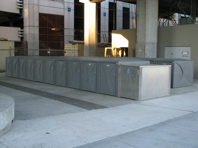 <b>Bicycle lockers at the Pleasant Hill BART station were also funded through Transportation Enhancements in 2003.</b>  The Iron Horse Regional Trail connects two counties and 12 cities along 33 miles of the Southern Pacific Railroad right-of-way.  Between 1997 and 2002, $3,107,000 in TE funds financed trail expansion and infrastructure, including under- and over-passes.  The Iron Horse Regional Trail is open to pedestrians, bicyclists, and equestrians.  The trail is a popular route for commuters as well as school children.  It is convenient to a Bay Area Rapid Transit (BART) station, bus stops, and park-and-ride facilities.  The trail passes through commercial areas that have benefited from the establishment of the trail.  Restaurants, ice cream parlors, and bicycle and sporting goods stores have specifically located themselves alongside the trail.  Many businesses now include bicycle parking in support of the trail.  The Iron Horse Regional Trail provides thousands of citizens an alternative way to travel while serving as a linear park and greenway providing habitat for wildlife.