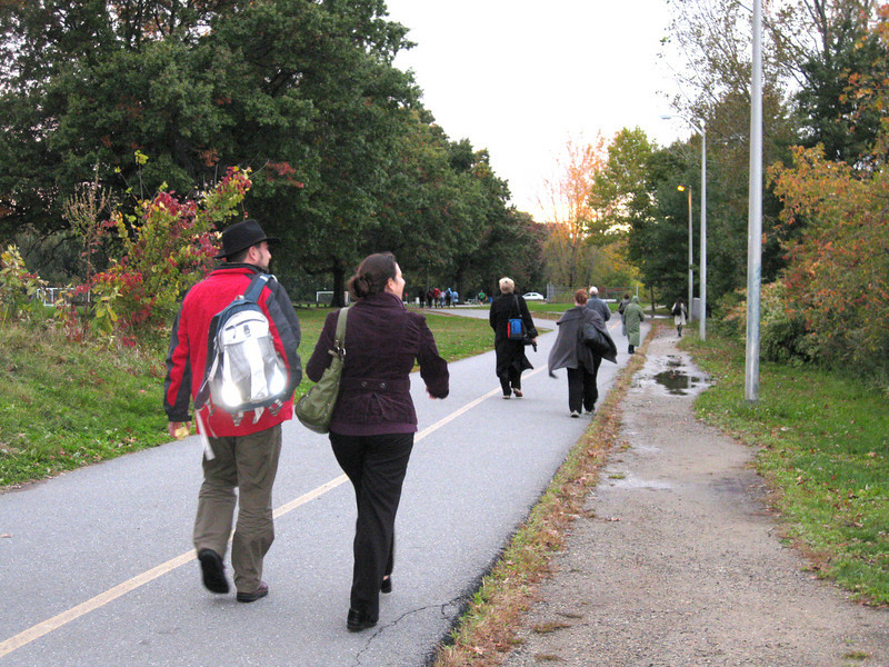 "At rush hour, the trail serves a constant stream of commuters walking home from the Alewife T Station.  The <a href=""http://www.minutemanbikeway.org"">Minuteman Bikeway</a> is an 11-mile rail-trail that connects Cambridge with Bedford, passing through Lexington and Arlington. This project converted an abandoned railroad, which provided passenger and freight service from 1846 to 1981 (Passenger service discontinued in 1977), into a multi-use bikeway. Over $2 million in federal TE funds were awarded to four projects that leveraged a total local match of nearly $530,000 to construct portions of the trail.   Connecting to the Alewife T Station in Cambridge, this bikeway serves as a regional connector providing pedestrians and bicyclists with access to subway and bus service. In addition, plowing in the winter makes the rail-trail accessible year-round. The Rails-to-Trails Conservancy inducted the Minuteman Bikeway into the national <a href=""http://www.railstotrails.org/ourWork/promotingTrailUse/trailRecognition/hallOfFame/index.html"">Rails-Trail Hall of Fame</a> in 2008. An interactive Google Map is available <a href=""http://maps.google.com/maps/ms?msa=0&msid=109226583957077835668.000465e72b5c80776ecd6&cd=20&geocode=FdjhgwIdyKe_-w&sll=41.524545,-73.895818&sspn=2.569111,6.049236&hl=en&ie=UTF8&ll=42.440434,-71.218529&spn=0.176595,0.308647&z=12"">here</a>."
