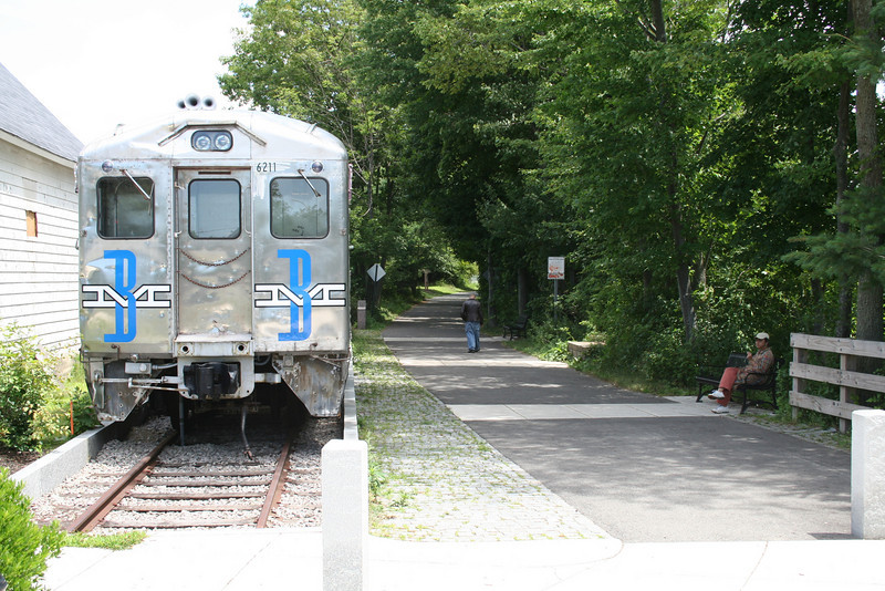 """The Minuteman Bikeway is in the right-of-way of the former Boston & Maine Railroad, which discontinued service in 1981.  The <a href=""""http://www.minutemanbikeway.org"""">Minuteman Bikeway</a> is an 11-mile rail-trail that connects Cambridge with Bedford, passing through Lexington and Arlington. This project converted an abandoned railroad, which provided passenger and freight service from 1846 to 1981 (Passenger service discontinued in 1977), into a multi-use bikeway. Over $2 million in federal TE funds were awarded to four projects that leveraged a total local match of nearly $530,000 to construct portions of the trail.   Connecting to the Alewife T Station in Cambridge, this bikeway serves as a regional connector providing pedestrians and bicyclists with access to subway and bus service. In addition, plowing in the winter makes the rail-trail accessible year-round. The Rails-to-Trails Conservancy inducted the Minuteman Bikeway into the national <a href=""""http://www.railstotrails.org/ourWork/promotingTrailUse/trailRecognition/hallOfFame/index.html"""">Rails-Trail Hall of Fame</a> in 2008. An interactive Google Map is available <a href=""""http://maps.google.com/maps/ms?msa=0&msid=109226583957077835668.000465e72b5c80776ecd6&cd=20&geocode=FdjhgwIdyKe_-w&sll=41.524545,-73.895818&sspn=2.569111,6.049236&hl=en&ie=UTF8&ll=42.440434,-71.218529&spn=0.176595,0.308647&z=12"""">here</a>."""