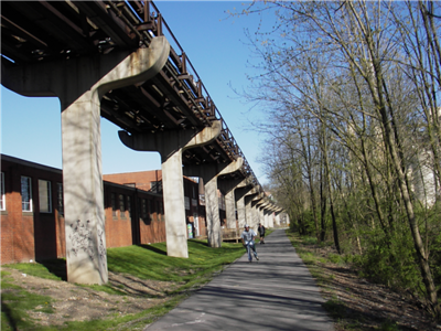 "Recreational opportunities abound in northern West Virginia, an area known for its scenic mountains and river valleys. Recognizing the value of recreation in the region, a nonprofit group, the <a href=""http://www.montrails.org/"">Mon River Trails Conservancy</a> (MRTC), formed in 1991 to acquire an abandoned CSX rail corridor and convert it to a trail. Working with a coalition of business organizations, government entities, and a local philanthropist, the group used TE funds to purchase and develop a 51-mile segment of abandoned rail corridor in 1996. Hugging the Monongahela River, the trail winds through three counties and several towns. North and south of the city of Morgantown, home of West Virginia University, the crushed limestone trail is called the Mon River Trail. Within Morgantown, an eight-mile paved segment known as the Caperton Trail provides access to riverfront parks, an amphitheatre, and the 90-acre Core Arboretum. East of Morgantown, the trail splits into the Decker's Creek Trail. The Mon River/Caperton/Decker's Creek Trail system augments the region's recreational opportunities, provides pedestrian and bicycle access to key destinations, and has helped to spur economic revitalization along the Monongahela River, including new businesses and a downtown hotel and conference center."