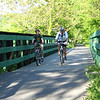"<b>Photo courtesy of Ella Belling</b>  Recreational opportunities abound in northern West Virginia, an area known for its scenic mountains and river valleys. Recognizing the value of recreation in the region, a nonprofit group, the <a href=""http://www.montrails.org/"">Mon River Trails Conservancy</a> (MRTC), formed in 1991 to acquire an abandoned CSX rail corridor and convert it to a trail. Working with a coalition of business organizations, government entities, and a local philanthropist, the group used TE funds to purchase and develop a 51-mile segment of abandoned rail corridor in 1996. Hugging the Monongahela River, the trail winds through three counties and several towns. North and south of the city of Morgantown, home of West Virginia University, the crushed limestone trail is called the Mon River Trail. Within Morgantown, an eight-mile paved segment known as the Caperton Trail provides access to riverfront parks, an amphitheatre, and the 90-acre Core Arboretum. East of Morgantown, the trail splits into the Decker's Creek Trail. The Mon River/Caperton/Decker's Creek Trail system augments the region's recreational opportunities, provides pedestrian and bicycle access to key destinations, and has helped to spur economic revitalization along the Monongahela River, including new businesses and a downtown hotel and conference center."