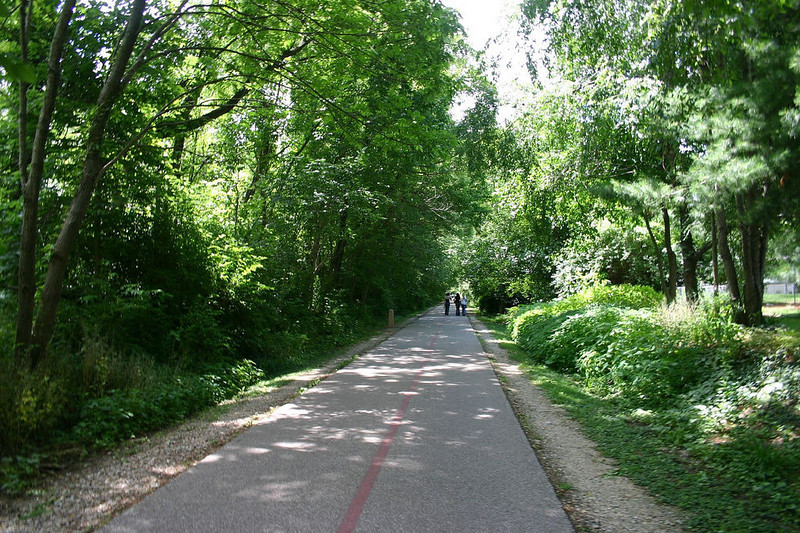"<a href=""http://www.flickr.com/photos/niteseeker/20179543/sizes/l/in/photostream/"">Photo Credit</a>   The Monon Trail or Monon Greenway as it is known locally is a 15.7 mile rail-trail stretching from Indianapolis to Carmel, Indiana. The trail sees about 1.3 million users a year and is a highly valued amenity among local citizens. Access to arts and entertainment is one of the highlights of the trail. The Indianapolis Art Center in Broad Ripple Village, Marott Park and Nature Preserve, Indiana State Fairgrounds, and the brand new Palladium at the Center for Performing Arts in Carmel are all easily accessible from the trail. Federal investment in the trail totals nearly $7,000,000 and has been matched by close to $4,700,000 in local funds. The asphalt trail connects many communities throughout the region and has been a significant economic boost for the local economy."