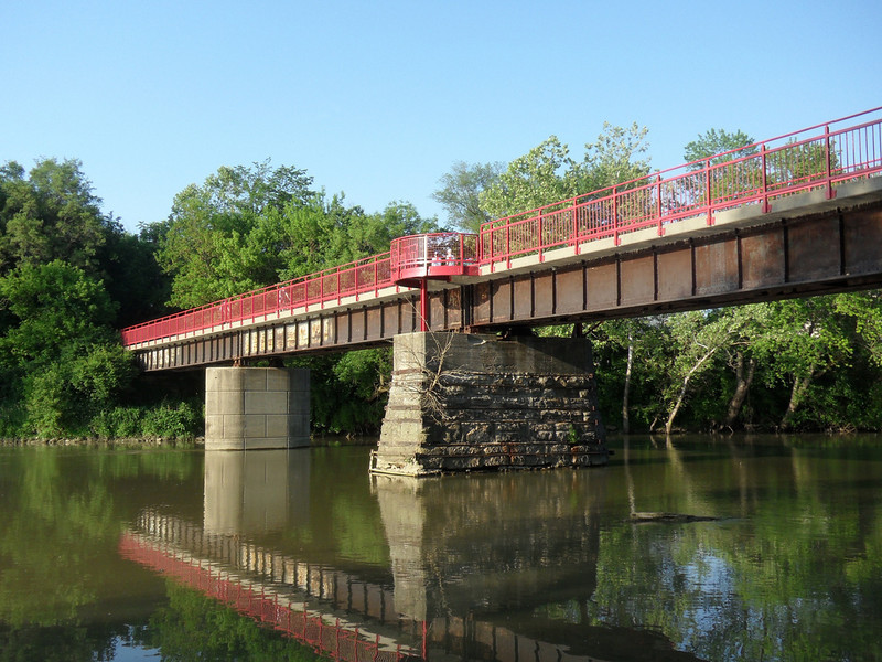 """<a href=""""http://www.flickr.com/photos/walkingsf/5460264720/sizes/l/in/photostream/"""">Photo Credit</a>  The Monon Trail or Monon Greenway as it is known locally is a 15.7 mile rail-trail stretching from Indianapolis to Carmel, Indiana. The trail sees about 1.3 million users a year and is a highly valued amenity among local citizens. Access to arts and entertainment is one of the highlights of the trail. The Indianapolis Art Center in Broad Ripple Village, Marott Park and Nature Preserve, Indiana State Fairgrounds, and the brand new Palladium at the Center for Performing Arts in Carmel are all easily accessible from the trail. Federal investment in the trail totals nearly $7,000,000 and has been matched by close to $4,700,000 in local funds. The asphalt trail connects many communities throughout the region and has been a significant economic boost for the local economy."""