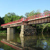 "<a href=""http://www.flickr.com/photos/walkingsf/5460264720/sizes/l/in/photostream/"">Photo Credit</a>  The Monon Trail or Monon Greenway as it is known locally is a 15.7 mile rail-trail stretching from Indianapolis to Carmel, Indiana. The trail sees about 1.3 million users a year and is a highly valued amenity among local citizens. Access to arts and entertainment is one of the highlights of the trail. The Indianapolis Art Center in Broad Ripple Village, Marott Park and Nature Preserve, Indiana State Fairgrounds, and the brand new Palladium at the Center for Performing Arts in Carmel are all easily accessible from the trail. Federal investment in the trail totals nearly $7,000,000 and has been matched by close to $4,700,000 in local funds. The asphalt trail connects many communities throughout the region and has been a significant economic boost for the local economy."