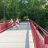 "<a href=""http://www.flickr.com/photos/walkingsf/5460263838/sizes/l/in/photostream/"">Photo Credit</a>  The Monon Trail or Monon Greenway as it is known locally is a 15.7 mile rail-trail stretching from Indianapolis to Carmel, Indiana. The trail sees about 1.3 million users a year and is a highly valued amenity among local citizens. Access to arts and entertainment is one of the highlights of the trail. The Indianapolis Art Center in Broad Ripple Village, Marott Park and Nature Preserve, Indiana State Fairgrounds, and the brand new Palladium at the Center for Performing Arts in Carmel are all easily accessible from the trail. Federal investment in the trail totals nearly $7,000,000 and has been matched by close to $4,700,000 in local funds. The asphalt trail connects many communities throughout the region and has been a significant economic boost for the local economy."