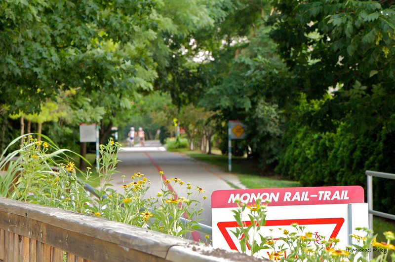 "<a href=""http://www.flickr.com/photos/mike_miley/4805519097/sizes/l/in/photostream/"">Photo Credit</a>  The Monon Trail or Monon Greenway as it is known locally is a 15.7 mile rail-trail stretching from Indianapolis to Carmel, Indiana. The trail sees about 1.3 million users a year and is a highly valued amenity among local citizens. Access to arts and entertainment is one of the highlights of the trail. The Indianapolis Art Center in Broad Ripple Village, Marott Park and Nature Preserve, Indiana State Fairgrounds, and the brand new Palladium at the Center for Performing Arts in Carmel are all easily accessible from the trail. Federal investment in the trail totals nearly $7,000,000 and has been matched by close to $4,700,000 in local funds. The asphalt trail connects many communities throughout the region and has been a significant economic boost for the local economy."