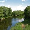 "View of the White River from the Monon Trail. <a href=""http://www.flickr.com/photos/katzenfinch/3734428648/in/photostream/"">Photo Credit</a>  The Monon Trail or Monon Greenway as it is known locally is a 15.7 mile rail-trail stretching from Indianapolis to Carmel, Indiana. The trail sees about 1.3 million users a year and is a highly valued amenity among local citizens. Access to arts and entertainment is one of the highlights of the trail. The Indianapolis Art Center in Broad Ripple Village, Marott Park and Nature Preserve, Indiana State Fairgrounds, and the brand new Palladium at the Center for Performing Arts in Carmel are all easily accessible from the trail. Federal investment in the trail totals nearly $7,000,000 and has been matched by close to $4,700,000 in local funds. The asphalt trail connects many communities throughout the region and has been a significant economic boost for the local economy."