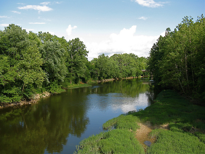"""View of the White River from the Monon Trail. <a href=""""http://www.flickr.com/photos/katzenfinch/3734428648/in/photostream/"""">Photo Credit</a>  The Monon Trail or Monon Greenway as it is known locally is a 15.7 mile rail-trail stretching from Indianapolis to Carmel, Indiana. The trail sees about 1.3 million users a year and is a highly valued amenity among local citizens. Access to arts and entertainment is one of the highlights of the trail. The Indianapolis Art Center in Broad Ripple Village, Marott Park and Nature Preserve, Indiana State Fairgrounds, and the brand new Palladium at the Center for Performing Arts in Carmel are all easily accessible from the trail. Federal investment in the trail totals nearly $7,000,000 and has been matched by close to $4,700,000 in local funds. The asphalt trail connects many communities throughout the region and has been a significant economic boost for the local economy."""