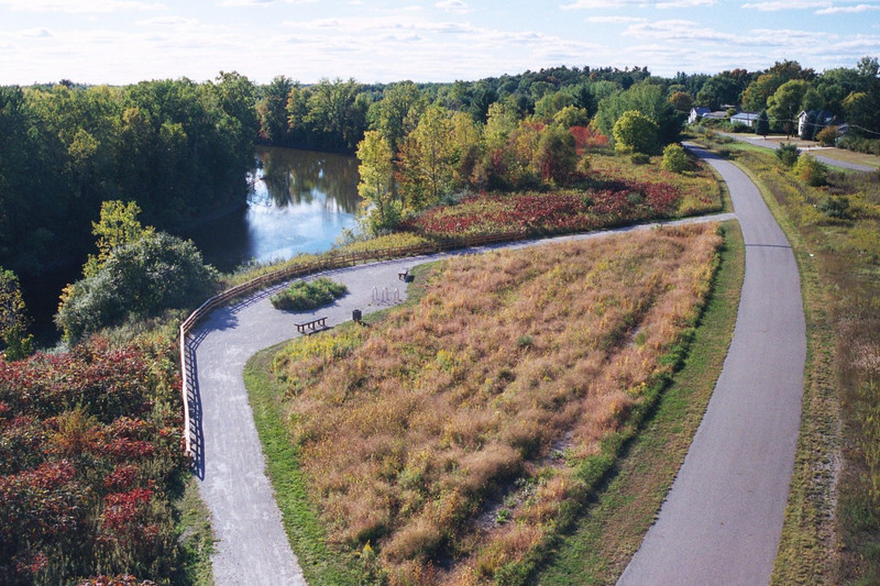 """Running through a 30-mile linear park constructed on an unused rail corridor, the <a href=""""http://www.lmb.org/pmrt/"""">Pere Marquette Rail-Trail</a> connects Midland and Isabella Counties and multiple cities. The trail offers walking, running, bicycling and in-line skating opportunities to people of all ages. In addition to its recreational benefits, the trail provides a safe alternative means of transportation for local residents traveling to and from work and area shopping districts. Twelve TE awards received between 1992 and 2010 financed the construction of the trail, improvements to watersheds, and a case study. The projects received over 4 million dollars and were matched by another 3 million in local matches. Nearly 2 million dollars in American Recovery and Reinvestment Act funds were also used. The initial award created a three mile trail through Midland. Over the ensuing years, Midland and Isabella Counties and the city of Midland used additional TE money for the construction of trail extensions and the paving and resurfacing of the trail. In recent years, TE money has been used to add lights, trash cans, benches, retaining walls, and to extend the trail even further."""
