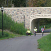 "Running through a 30-mile linear park constructed on an unused rail corridor, the <a href=""http://www.lmb.org/pmrt/"">Pere Marquette Rail-Trail</a> connects Midland and Isabella Counties and multiple cities. The trail offers walking, running, bicycling and in-line skating opportunities to people of all ages. In addition to its recreational benefits, the trail provides a safe alternative means of transportation for local residents traveling to and from work and area shopping districts. Twelve TE awards received between 1992 and 2010 financed the construction of the trail, improvements to watersheds, and a case study. The projects received over 4 million dollars and were matched by another 3 million in local matches. Nearly 2 million dollars in American Recovery and Reinvestment Act funds were also used. The initial award created a three mile trail through Midland. Over the ensuing years, Midland and Isabella Counties and the city of Midland used additional TE money for the construction of trail extensions and the paving and resurfacing of the trail. In recent years, TE money has been used to add lights, trash cans, benches, retaining walls, and to extend the trail even further."