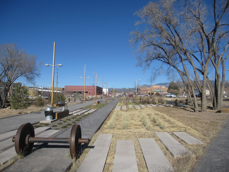 "The <a href=""http://www.railyardsantafe.com/rails-and-trails.php"">Santa Fe Rail Trail</a>, which begins at Rabbit Road in Santa Fe and terminates in Lamy, runs adjacent to the <a href=""http://www.nmrailrunner.com"">Rail Runner Express commuter train</a> and <a href=""http://sfsr.com/about.html"">Santa Fe Southern Railway</a>, a 120 year old spur. The 11.5 mile rail-trail is a mix of pavement and dirt and was funded through a variety of public sources as well as private donations raised by the Santa Fe Conservation Trust. Specifically, the rail-trail received three separate TE grants in 1998 and 2005 amounting to $999,750 leveraging a local match of $333,250. Walkers, joggers, mountain bicyclists, and equestrians enjoy this community treasure."