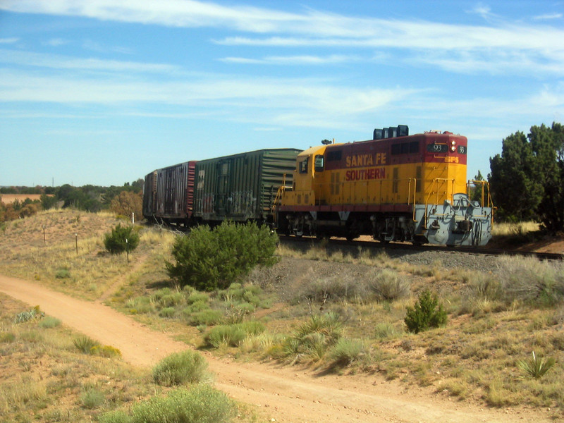 """The <a href=""""http://www.railyardsantafe.com/rails-and-trails.php"""">Santa Fe Rail Trail</a>, which begins at Rabbit Road in Santa Fe and terminates in Lamy, runs adjacent to the <a href=""""http://www.nmrailrunner.com"""">Rail Runner Express commuter train</a> and <a href=""""http://sfsr.com/about.html"""">Santa Fe Southern Railway</a>, a 120 year old spur. The 11.5 mile rail-trail is a mix of pavement and dirt and was funded through a variety of public sources as well as private donations raised by the Santa Fe Conservation Trust. Specifically, the rail-trail received three separate TE grants in 1998 and 2005 amounting to $999,750 leveraging a local match of $333,250. Walkers, joggers, mountain bicyclists, and equestrians enjoy this community treasure.  Photo by Pat Tomes."""