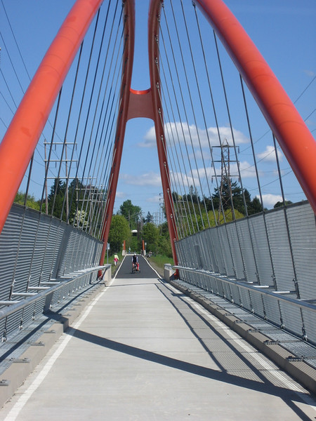 This project extends the Springwater trail, a multi-use path on an abandoned railroad line, over McLoughlin Boulevard, the Union Pacific Railroad and Johnson Creek with the construction of three major bridges. Each Bridge is built to respond to the feature they are crossing. The suspension arch bridge over Mcloughlin Boulevard also doubles as a gateway to the community both because of its shape and color. Awarded TE funds in 2003, the project was completed in the fall of 2006. Federal Share $4,209,233.00 Match $481,767 Total $4,691,000