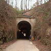"Tunnel along the Silver Comet Trail<br /> <br /> The Silver Comet Trail, one of the most popular spots in northwest Georgia for outdoor recreation and bicycle commuting, sprouted from an abandoned rail corridor between Atlanta and the Alabama state line. In the early 1990s, a group of private citizens and non-profit organizations, including the PATH Foundation and the Georgia Rails to Trails Society, spearheaded the development of the trail, working with the Georgia Department of Transportation (GDOT), the Georgia Department of Natural Resources and the three counties adjacent to the trail: Cobb, Paulding and Polk. GDOT purchased the 57-mile corridor in 1992 from CSX for $5.8 million. Today, the trail passes through three Georgia counties and connects with the Chief Ladiga Trail in Cleburne County, Alabama.  These two trails combined run over 100 miles and form the longest paved trail in the United States.<br /> <br /> Development of the Silver Comet Trail was supported by TE grants in 1998 ($695,000 with a $173,750 local match from the City of Rockmart), 2000 ($400,000 with a $202,840 local match from the Cobb County DOT; $50,000 with a $12,500 local match from the Paulding County Chamber of Commerce; and $959,000 with a $239,750 local match from Polk County),  2001 ($875,000 with a $343,200 local match from GDOT), and 2004 ($750,000 with a local match of $187,500 from the Cobb County DOT).  The grants and matches total $4,888,540.<br /> <br /> Learn more about The Silver Comet Trail at <a href=""http://www.silvercometga.com/"">http://www.silvercometga.com/</a> and <a href=""http://www.silvercomet.org/"">http://www.silvercomet.org/</a>."