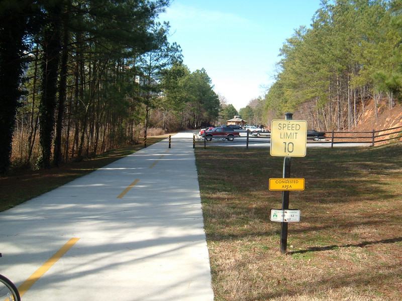 "parking area at a Silver Comet trailhead<br /> <br /> The Silver Comet Trail, one of the most popular spots in northwest Georgia for outdoor recreation and bicycle commuting, sprouted from an abandoned rail corridor between Atlanta and the Alabama state line. In the early 1990s, a group of private citizens and non-profit organizations, including the PATH Foundation and the Georgia Rails to Trails Society, spearheaded the development of the trail, working with the Georgia Department of Transportation (GDOT), the Georgia Department of Natural Resources and the three counties adjacent to the trail: Cobb, Paulding and Polk. GDOT purchased the 57-mile corridor in 1992 from CSX for $5.8 million. Today, the trail passes through three Georgia counties and connects with the Chief Ladiga Trail in Cleburne County, Alabama.  These two trails combined run over 100 miles and form the longest paved trail in the United States.<br /> <br /> Development of the Silver Comet Trail was supported by TE grants in 1998 ($695,000 with a $173,750 local match from the City of Rockmart), 2000 ($400,000 with a $202,840 local match from the Cobb County DOT; $50,000 with a $12,500 local match from the Paulding County Chamber of Commerce; and $959,000 with a $239,750 local match from Polk County),  2001 ($875,000 with a $343,200 local match from GDOT), and 2004 ($750,000 with a local match of $187,500 from the Cobb County DOT).  The grants and matches total $4,888,540.<br /> <br /> Learn more about The Silver Comet Trail at <a href=""http://www.silvercometga.com/"">http://www.silvercometga.com/</a> and <a href=""http://www.silvercomet.org/"">http://www.silvercomet.org/</a>."