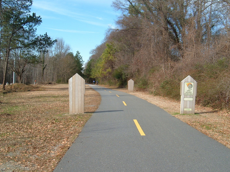 "Silver Comet trail<br /> <br /> The Silver Comet Trail, one of the most popular spots in northwest Georgia for outdoor recreation and bicycle commuting, sprouted from an abandoned rail corridor between Atlanta and the Alabama state line. In the early 1990s, a group of private citizens and non-profit organizations, including the PATH Foundation and the Georgia Rails to Trails Society, spearheaded the development of the trail, working with the Georgia Department of Transportation (GDOT), the Georgia Department of Natural Resources and the three counties adjacent to the trail: Cobb, Paulding and Polk. GDOT purchased the 57-mile corridor in 1992 from CSX for $5.8 million. Today, the trail passes through three Georgia counties and connects with the Chief Ladiga Trail in Cleburne County, Alabama.  These two trails combined run over 100 miles and form the longest paved trail in the United States.<br /> <br /> Development of the Silver Comet Trail was supported by TE grants in 1998 ($695,000 with a $173,750 local match from the City of Rockmart), 2000 ($400,000 with a $202,840 local match from the Cobb County DOT; $50,000 with a $12,500 local match from the Paulding County Chamber of Commerce; and $959,000 with a $239,750 local match from Polk County),  2001 ($875,000 with a $343,200 local match from GDOT), and 2004 ($750,000 with a local match of $187,500 from the Cobb County DOT).  The grants and matches total $4,888,540.<br /> <br /> Learn more about The Silver Comet Trail at <a href=""http://www.silvercometga.com/"">http://www.silvercometga.com/</a> and <a href=""http://www.silvercomet.org/"">http://www.silvercomet.org/</a>."
