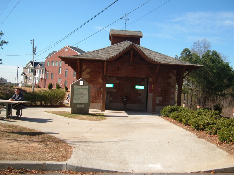 """Restroom facilities at a Silver Comet trailhead<br /> <br /> The Silver Comet Trail, one of the most popular spots in northwest Georgia for outdoor recreation and bicycle commuting, sprouted from an abandoned rail corridor between Atlanta and the Alabama state line. In the early 1990s, a group of private citizens and non-profit organizations, including the PATH Foundation and the Georgia Rails to Trails Society, spearheaded the development of the trail, working with the Georgia Department of Transportation (GDOT), the Georgia Department of Natural Resources and the three counties adjacent to the trail: Cobb, Paulding and Polk. GDOT purchased the 57-mile corridor in 1992 from CSX for $5.8 million. Today, the trail passes through three Georgia counties and connects with the Chief Ladiga Trail in Cleburne County, Alabama.  These two trails combined run over 100 miles and form the longest paved trail in the United States.<br /> <br /> Development of the Silver Comet Trail was supported by TE grants in 1998 ($695,000 with a $173,750 local match from the City of Rockmart), 2000 ($400,000 with a $202,840 local match from the Cobb County DOT; $50,000 with a $12,500 local match from the Paulding County Chamber of Commerce; and $959,000 with a $239,750 local match from Polk County),  2001 ($875,000 with a $343,200 local match from GDOT), and 2004 ($750,000 with a local match of $187,500 from the Cobb County DOT).  The grants and matches total $4,888,540.<br /> <br /> Learn more about The Silver Comet Trail at <a href=""""http://www.silvercometga.com/"""">http://www.silvercometga.com/</a> and <a href=""""http://www.silvercomet.org/"""">http://www.silvercomet.org/</a>."""