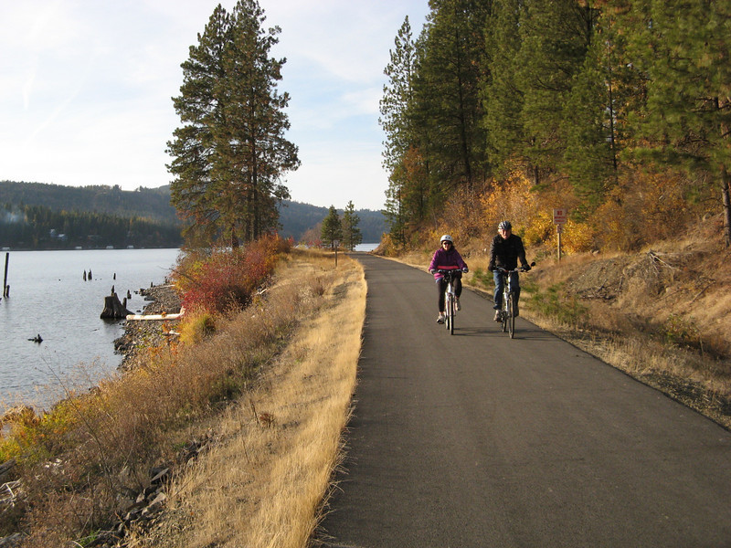 The Trail of the Coeur d'Alenes is a magnificent 72-mile trail, one of the longest continuously paved rail-trails in the country. The trail follows the Union Pacific Railroad's right-of-way from Mullan, a mountain mining town near the Montana border, through the Silver Valley, into the chain lakes region, over a 3,100-foot bridge to Heyburn State Park and then on to the Coeur d'Alene Indian Reservation, ending in Plummer near the Washington border. Interpretive signs along the way tell the story of the region's rich history. Numerous trailheads, restroom facilities, picnic tables and benches dot the length of the trail. This enormous effort, costing nearly $50 million, was initiated as a cleanup of historic mining waste and wildlife mitigation. Many cooperating actors were involved because of its nature and extent. Key partners were the Coeur d'Alene Tribe, Union Pacific Railroad, Idaho Parks and Recreation, Idaho Department of Environmental Quality, and the U.S. Environmental Protection Agency. In 1999, one million dollars in TE funds were used for paving the eastern portion of the trail. The Coeur d'Alene Tribe and Parks and Recreation manage the trail jointly. After transfer of the right-of-way to the trail managers, Union Pacific Railroad will continue to be responsible for some aspects of trail maintenance.