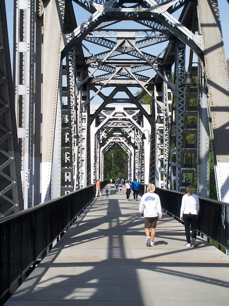 """In 2004, the City of Salem purchased the Union Street Railroad Bridge and its associated timber trestle from Pacific Union Railroad for $1. In 2009, the city finished converting it into a multi-use pathway for pedestrians, bicyclists, and other non-motorized users. The bridge, originally built in 1912-13, crosses a half-mile span of the Willamette River. The project improved bicycle and pedestrian safety and access, and provided a critical link in local, state, and regional trail networks.<br /> <br /> On April 18, 2009, hundreds of people joined local and state officials for the project's grand opening ceremony and an inaugural trip across the bridge. The project was awarded TE funds in 2003. Federal Award: $2,016,000; Local Match: $1,383,108; Total: $3,399,108<br /> <br /> To take a virtual walk across the bridge visit  <a href=""""http://www.youtube.com/watch?v=uQDrhOQfwJc"""">http://www.youtube.com/watch?v=uQDrhOQfwJc</a><br /> <br /> Photo Credit: City of Salem"""