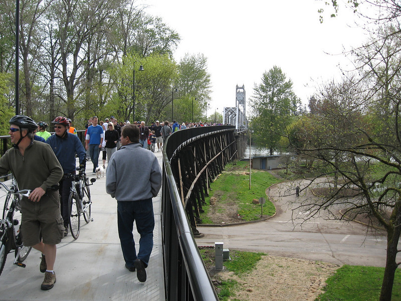 "In 2004, the City of Salem purchased the Union Street Railroad Bridge and its associated timber trestle from Pacific Union Railroad for $1. In 2009, the city finished converting it into a multi-use pathway for pedestrians, bicyclists, and other non-motorized users. The bridge, originally built in 1912-13, crosses a half-mile span of the Willamette River. The project improved bicycle and pedestrian safety and access, and provided a critical link in local, state, and regional trail networks.<br /> <br /> On April 18, 2009, hundreds of people joined local and state officials for the project's grand opening ceremony and an inaugural trip across the bridge. The project was awarded TE funds in 2003. Federal Award: $2,016,000; Local Match: $1,383,108; Total: $3,399,108<br /> <br /> To take a virtual walk across the bridge visit  <a href=""http://www.youtube.com/watch?v=uQDrhOQfwJc"">http://www.youtube.com/watch?v=uQDrhOQfwJc</a><br /> <br /> Photo credit: Pat & Chuck Fisher"