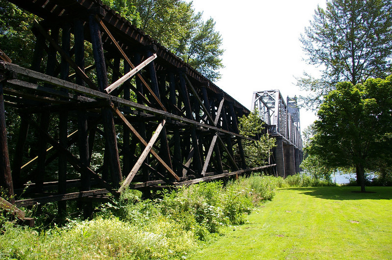 "The bridge's timber trestle.<br /> <br /> In 2004, the City of Salem purchased the Union Street Railroad Bridge and its associated timber trestle from Pacific Union Railroad for $1. In 2009, the city finished converting it into a multi-use pathway for pedestrians, bicyclists, and other non-motorized users. The bridge, originally built in 1912-13, crosses a half-mile span of the Willamette River. The project improved bicycle and pedestrian safety and access, and provided a critical link in local, state, and regional trail networks.<br /> <br /> On April 18, 2009, hundreds of people joined local and state officials for the project's grand opening ceremony and an inaugural trip across the bridge. The project was awarded TE funds in 2003. Federal Award: $2,016,000; Local Match: $1,383,108; Total: $3,399,108<br /> <br /> To take a virtual walk across the bridge visit  <a href=""http://www.youtube.com/watch?v=uQDrhOQfwJc"">http://www.youtube.com/watch?v=uQDrhOQfwJc</a><br /> <br /> Photo credit: Pat & Chuck Fisher"