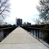 "In 2004, the City of Salem purchased the Union Street Railroad Bridge and its associated timber trestle from Pacific Union Railroad for $1. In 2009, the city finished converting it into a multi-use pathway for pedestrians, bicyclists, and other non-motorized users. The bridge, originally built in 1912-13, crosses a half-mile span of the Willamette River. The project improved bicycle and pedestrian safety and access, and provided a critical link in local, state, and regional trail networks.<br /> <br /> On April 18, 2009, hundreds of people joined local and state officials for the project's grand opening ceremony and an inaugural trip across the bridge. The project was awarded TE funds in 2003. Federal Award: $2,016,000; Local Match: $1,383,108; Total: $3,399,108<br /> <br /> To take a virtual walk across the bridge visit  <a href=""http://www.youtube.com/watch?v=uQDrhOQfwJc"">http://www.youtube.com/watch?v=uQDrhOQfwJc</a><br /> <br /> Photo Credit: City of Salem"