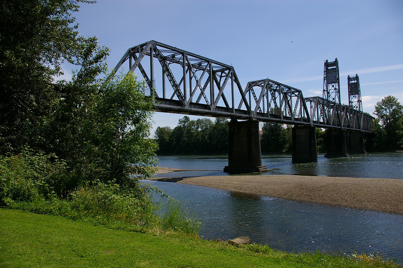 """In 2004, the City of Salem purchased the Union Street Railroad Bridge and its associated timber trestle from Pacific Union Railroad for $1. In 2009, the city finished converting it into a multi-use pathway for pedestrians, bicyclists, and other non-motorized users. The bridge, originally built in 1912-13, crosses a half-mile span of the Willamette River. The project improved bicycle and pedestrian safety and access, and provided a critical link in local, state, and regional trail networks.<br /> <br /> On April 18, 2009, hundreds of people joined local and state officials for the project's grand opening ceremony and an inaugural trip across the bridge. The project was awarded TE funds in 2003. Federal Award: $2,016,000; Local Match: $1,383,108; Total: $3,399,108<br /> <br /> To take a virtual walk across the bridge visit  <a href=""""http://www.youtube.com/watch?v=uQDrhOQfwJc"""">http://www.youtube.com/watch?v=uQDrhOQfwJc</a><br /> <br /> Photo credit: Pat & Chuck Fisher"""