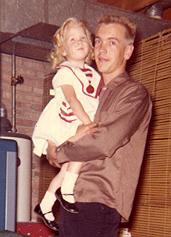 Chuck Larsen holding little sister Nina copy