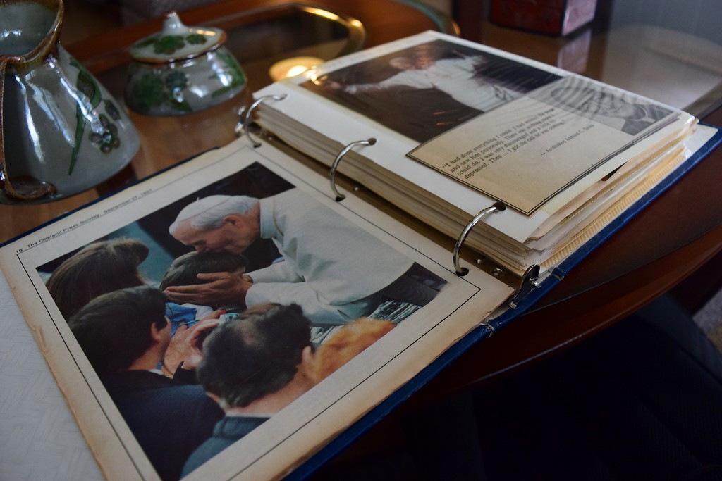 . Joyce Frias, 84 of White Lake,  secretary for the late Father William Easton of St. Vincent de Paul Catholic Church during the visit, keeps a scrapbook full of memories from the planning and visit by the pope in 1987. Photo by Natalie Broda - Digital First Media